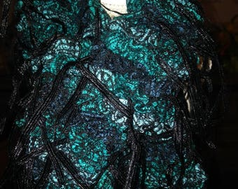 Beautiful turquoise scarf with black ribbons