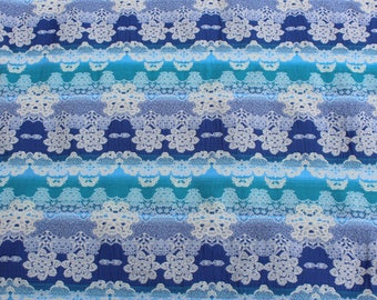 Fabric in shades of blue, turquoise, grey and Ecru jacquard
