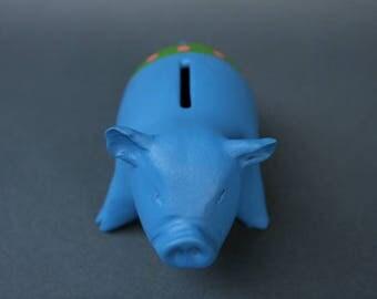Piggy Bank Artwork: Stretching Blue