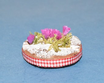 Easter table decoration wood bark and pink flowers