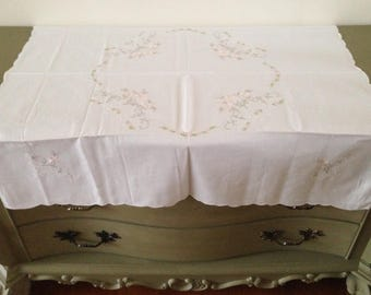 Vintage cotton tablecloth with embroidery and shell edge.