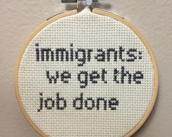 "Hamilton cross stitch ""Immigrants: we get the job done"""