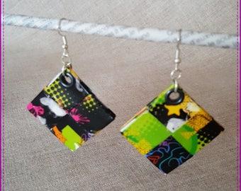 Pierced earrings mutilcolore on black background