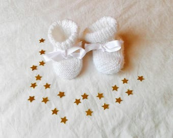 Baby white wool and satin ribbons