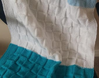 A hand-knit baby blanket.