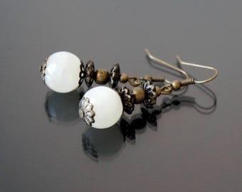 Off white stud earrings.