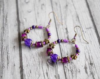 Purple glass beads hoop earrings.