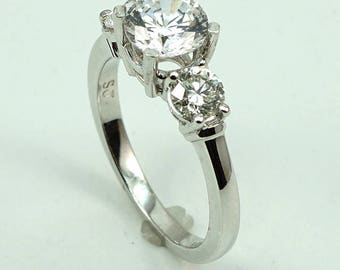 Platinum Engagement Ring CZ Center Stone with 2-Diam Side Stones at 0.64 Cts.