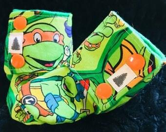 Ninja Turtles stay on booties, TMNT