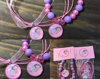 Dora the explora party favors.Dora bead bracelet.Dora pendant necklace.Dora birthday party.Dora gift set