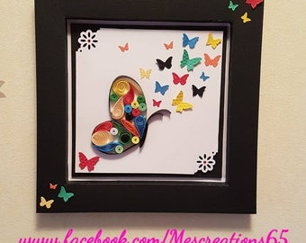 Example frame quilling paper - wall decoration with multicolored butterflies