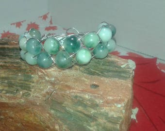 Wire wrapped bracelet with green spotted quartz beads.