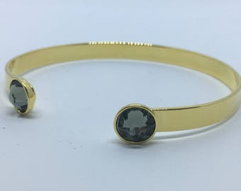 Gold Bangle with two 7mm black SWAROVSKI crystals.