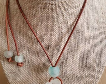 Handpicked genuine sea glass. One of a kind. In tact bottle top and recycled glass bead on leather cord. Adjustable