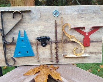 Family Sign on Scrap Wood - made with re-purposed hardware.