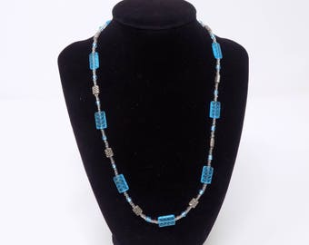 Necklace with blue glass beads and silver accents