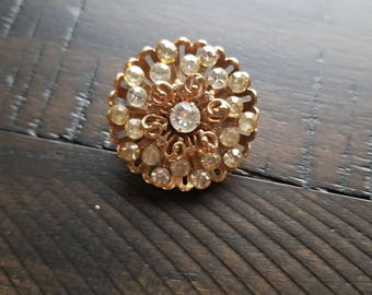 Vintage gold colored brooch with rhinestone throughout