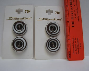 Two sets of Streamline plastic buttons
