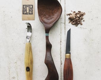 Hand carved walnut cooking/serving spoon.