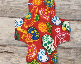 "Heavy flow microfleece backed 9 inch pad ""day of the dead"""