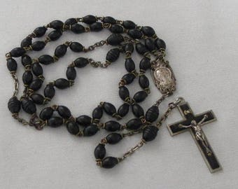 Vintage French long rosary with black beads and carved beads inbetween. 59 beaded with crucifix