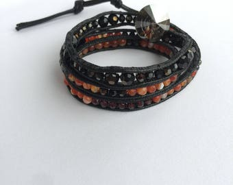 A wrap bracelet with agate and Swarovski crystals.