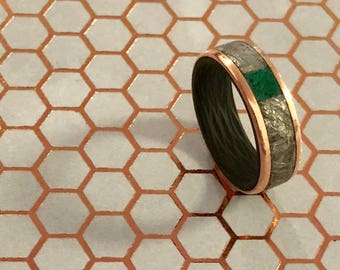 Gibeon meteorite rings with carbon fiber liner with your choice of inlay material or all meteorite.
