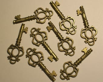 "8 Small Double Sided Bronze Keys 1 5/8"" in length & 5/8"" in width. DIY Crafts. Jewelry Supplies."