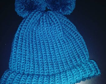 Handmade hat with two pompoms