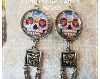 Earrings with cabochon death