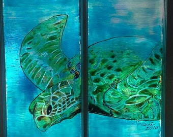 Underwater swimming great sea turtle. Stained glass painted old wood window.