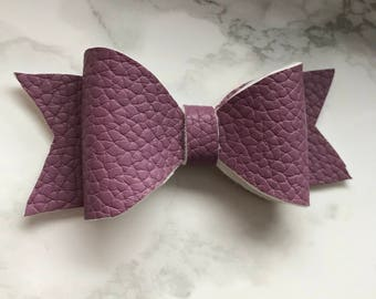 Purple leather bow