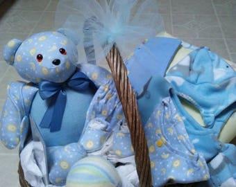Baby boy or girl gift basket inc: bear, bib, wipe cloths, crib blanket, 2 pc. Pj set, fleece coat, hat, mitten set, play ball, slippers.