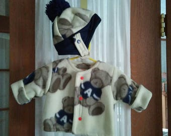 Fleece jacket 3 - 6 mo. in ivory & navy teddy bear theme. Snap front. Hat w/ pom pom, over ear panel, loup tie. Thumbless mitts. Items lined