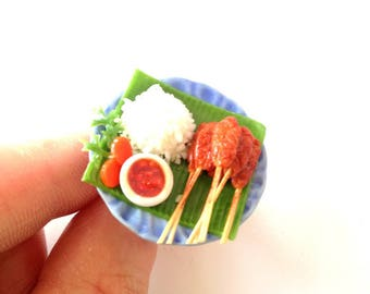 Ring -- The Little VIETNAMESE RESTAURANT, miniature skewers with rice, ring by The Sausage