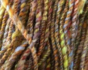 Sunset handspun handcarded and dyed wool art yarn 126 yards 3 oz 2 ply