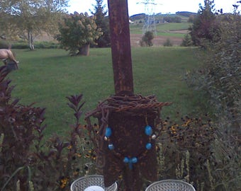 Vintage fence post with candle holders