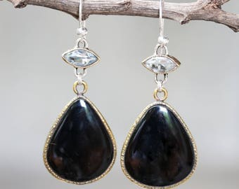 Black onyx in drop shape and marquis blue topaz earrings in brass bezel setting with sterling silver hooks style/TP