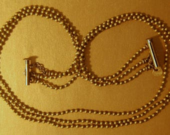 Hand knotted 3 strand solid brass 2.3mm round beaded necklace with a 3 strand magnetic clasp