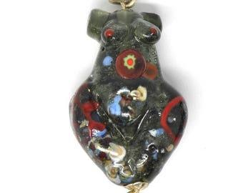 dark transparent spraggled grey Goddess bead