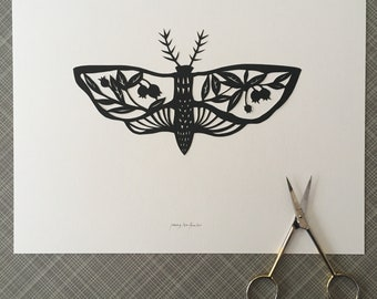 Moth Silhouette Papercutting with Blueberries