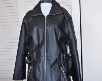 Black  Leather Jacket.Zipper closure.Leather wrap belt. Black Nylon,Quilted lining.Lots of Metal Zippers. sleeves and outer pockets.Preowned