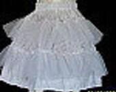 Petticoat slip with netting ruffles