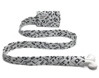 Music notes TuneTube.  Earbud cord organizer for iPhone or iPod.  Cord keeper.  Earbud holder.  Earbud case.