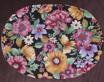 Oval placemats with realistic flower design; reverse is multicolored, set  of 4