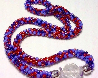 Beaded Red and Purple  Necklace With Crystal Focal Bead