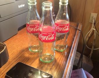 3 8 oz Coke bottles. Upcycle
