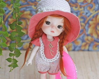 Patterns and English Instructions of Romper and Hat for Lati Yellow