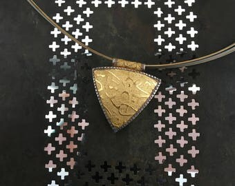 Gold and Silver Hollow Form Triangle Pendant