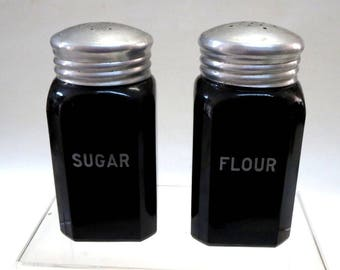 Hazel Atlas Glass Fired On Black Sugar and Flour Range Shakers Rare Find